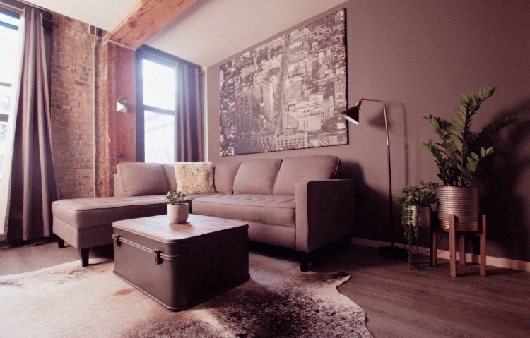 Large cowhide rug industrial loft in Montreal